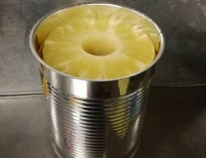 สับปะรดชนิดแว่นบรรจุกระป๋องในน้ำสับปะรด ขนาด 20 ออนซ์ น้ำหนักสุทธิ 565 กรัม